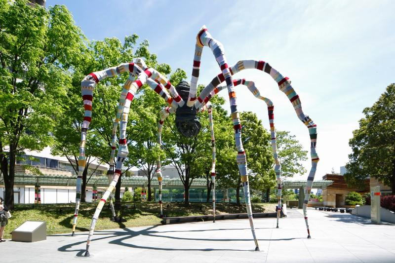 Louise Bourgeois's 1999 bronze sculpture Maman wrapped in fabric by Magda Sayeg in a temporary installation at Roppongi Hills, Tokyo